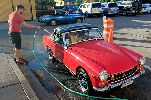 Rosie the MG Midget gets a bath from Tyler after enduring a lost alternator nut