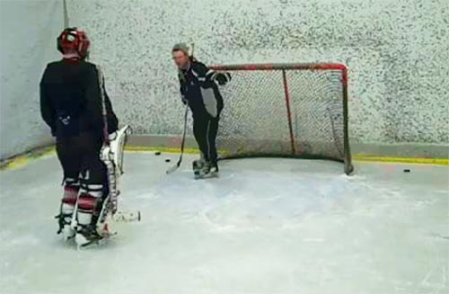 Getting some pointers from my goalie coach
